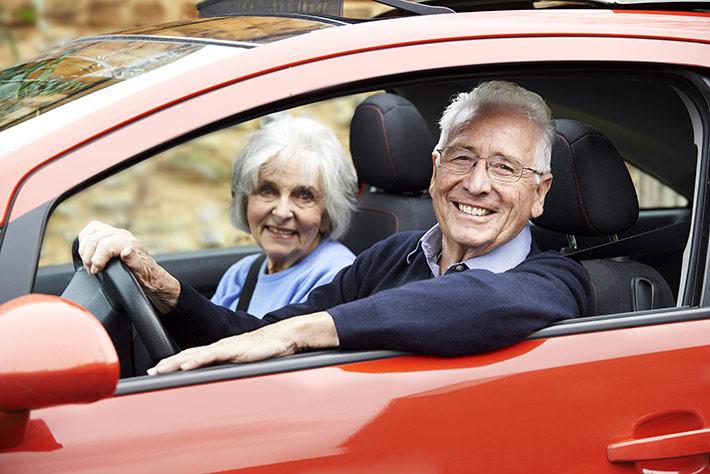 Older Man Driving Car Through Desert Comercial